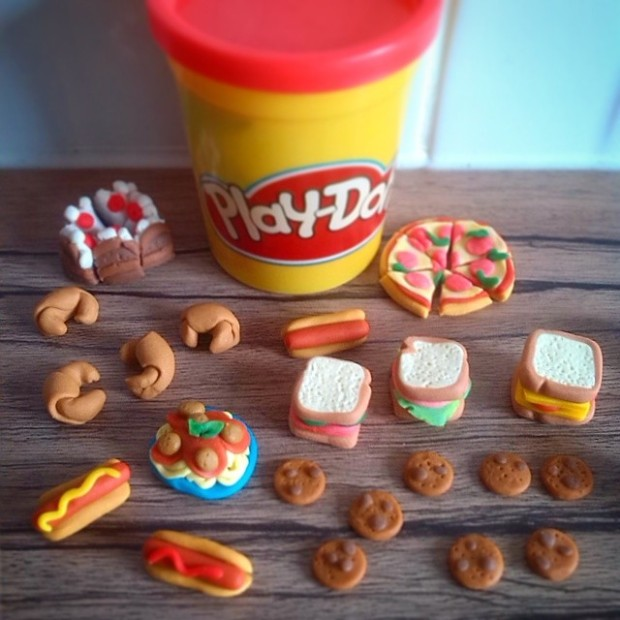 Miniature Play-Doh food including mini chocolate cake, pizza, hot dogs, sandwiches, cookies, spaghetti bolognese and croissant