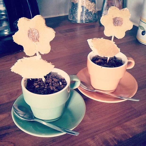 Flowers made from pancakes in a flower pot filled with chocolate cake