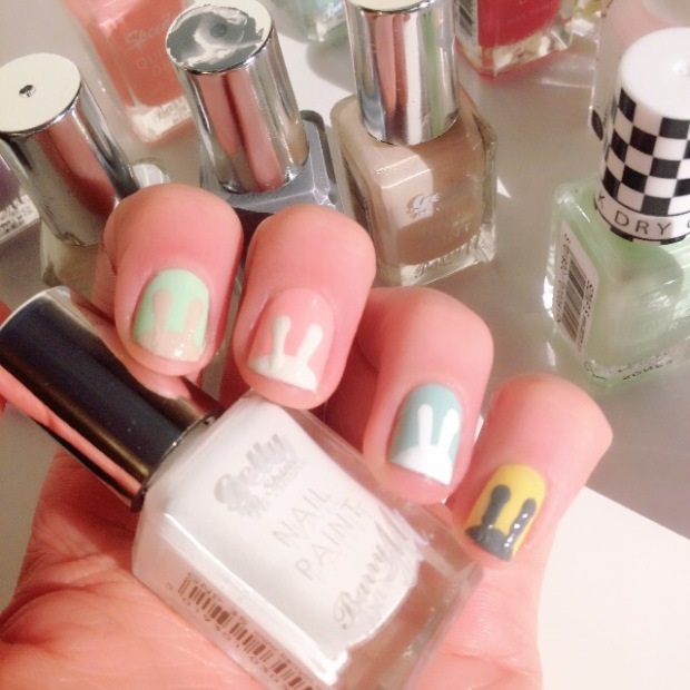 Pastel shades and spring colours used in an Easter Bunny themed nail art design