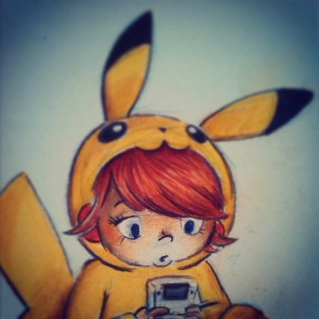 Pokéfan playing a Gameboy in a Pikachu onesie