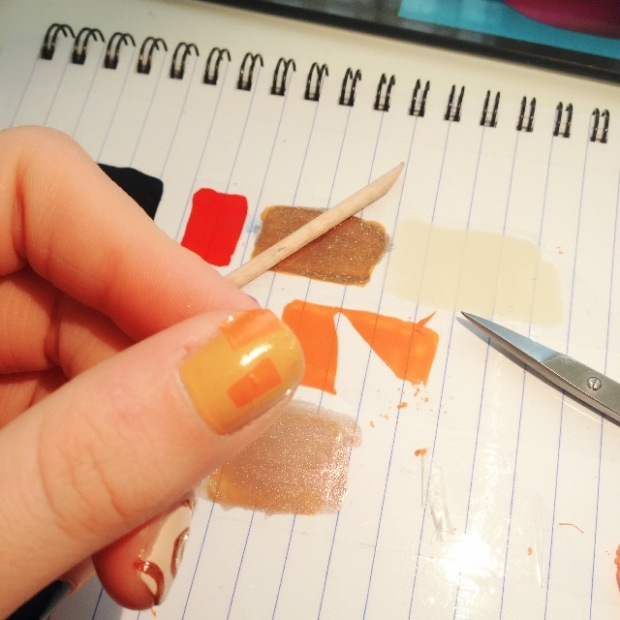 Cutting small pieces from the nail polish swatch and applying them directly to nails