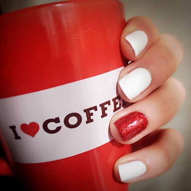 Matte White and Red Glitter Nails holding a red coffee mug